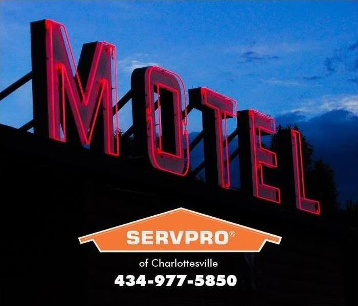 motel sign against night sky